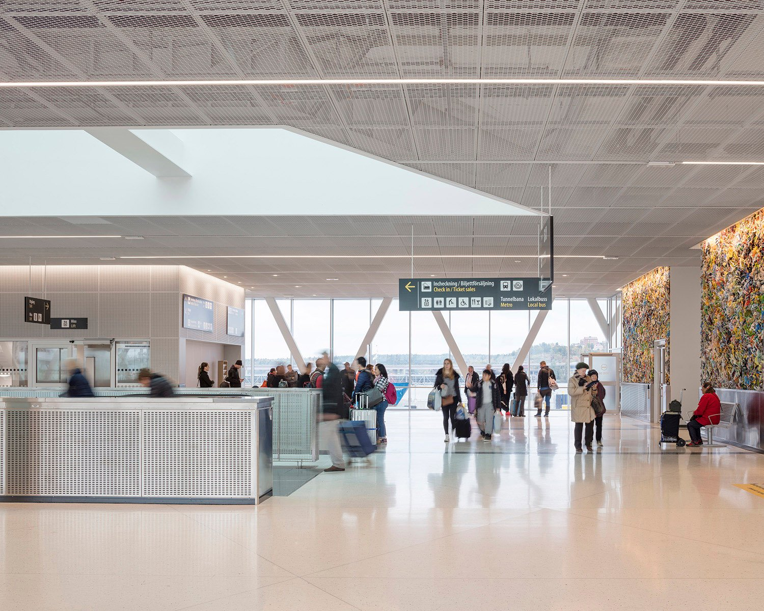 The arrival hall with views of the harbor and artwork by Matthias van Arkel