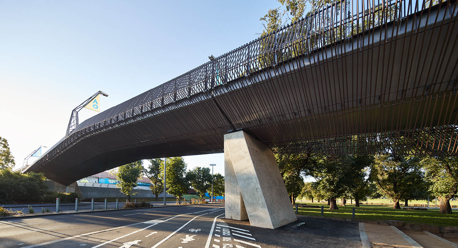 The bridge design is slender, a flat steel girder structure that tapers at its edges to achieve the required span across Batman Avenue