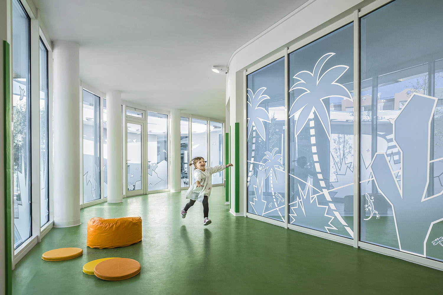 View of the corridor with safety artistic decoration on the glass facades  photo by Alessandro Peralta