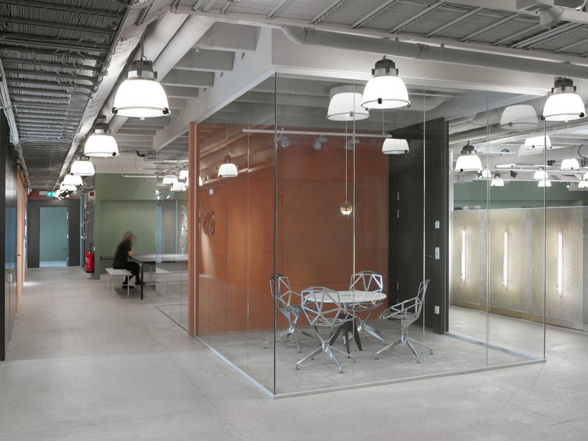 The layout of the building gives us limited natural light to work with, transparency is everything.