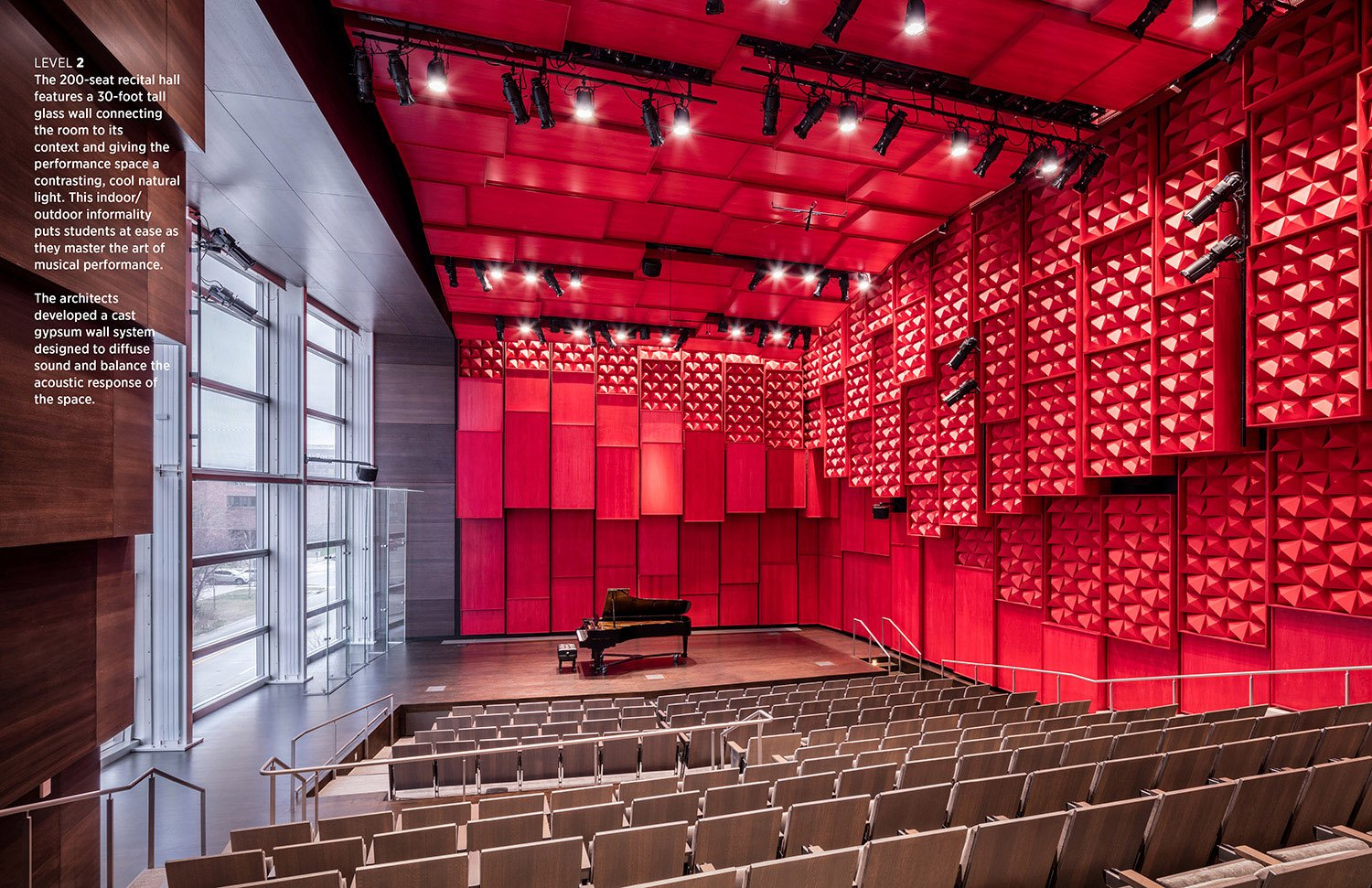 The 200-seat recital hall at the second level features a 30-foot tall glass wall connecting the room to its context and giving the performance space a contrasting, cool natural light. This indoor/outdoor i Tim Griffith