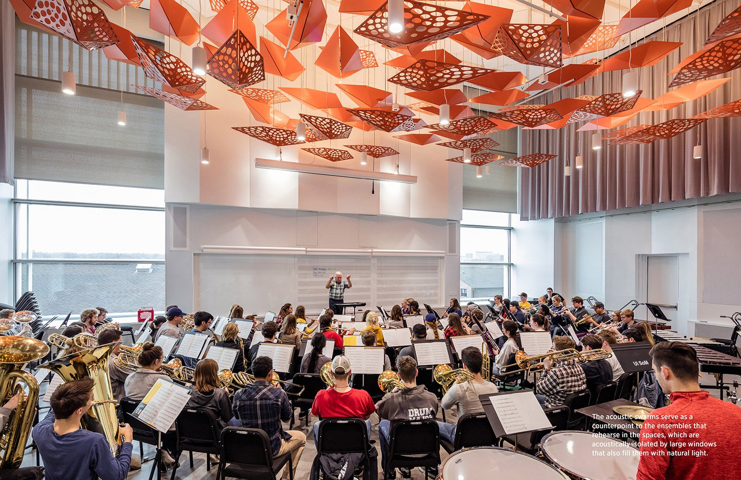 The acoustic swarms serve as a counterpoint to the ensembles that rehearse in the spaces, which are acoustically isolated by large windows that also fill them with natural light. Tim Griffith}