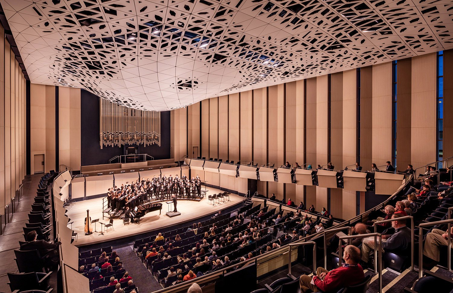 The 700-seat concert hall is a traditional shoebox-style room and frames the theatroacoustic system above. The room features variable acoustics to accommodate a variety of acoustic and amplified music. Tim Griffith}