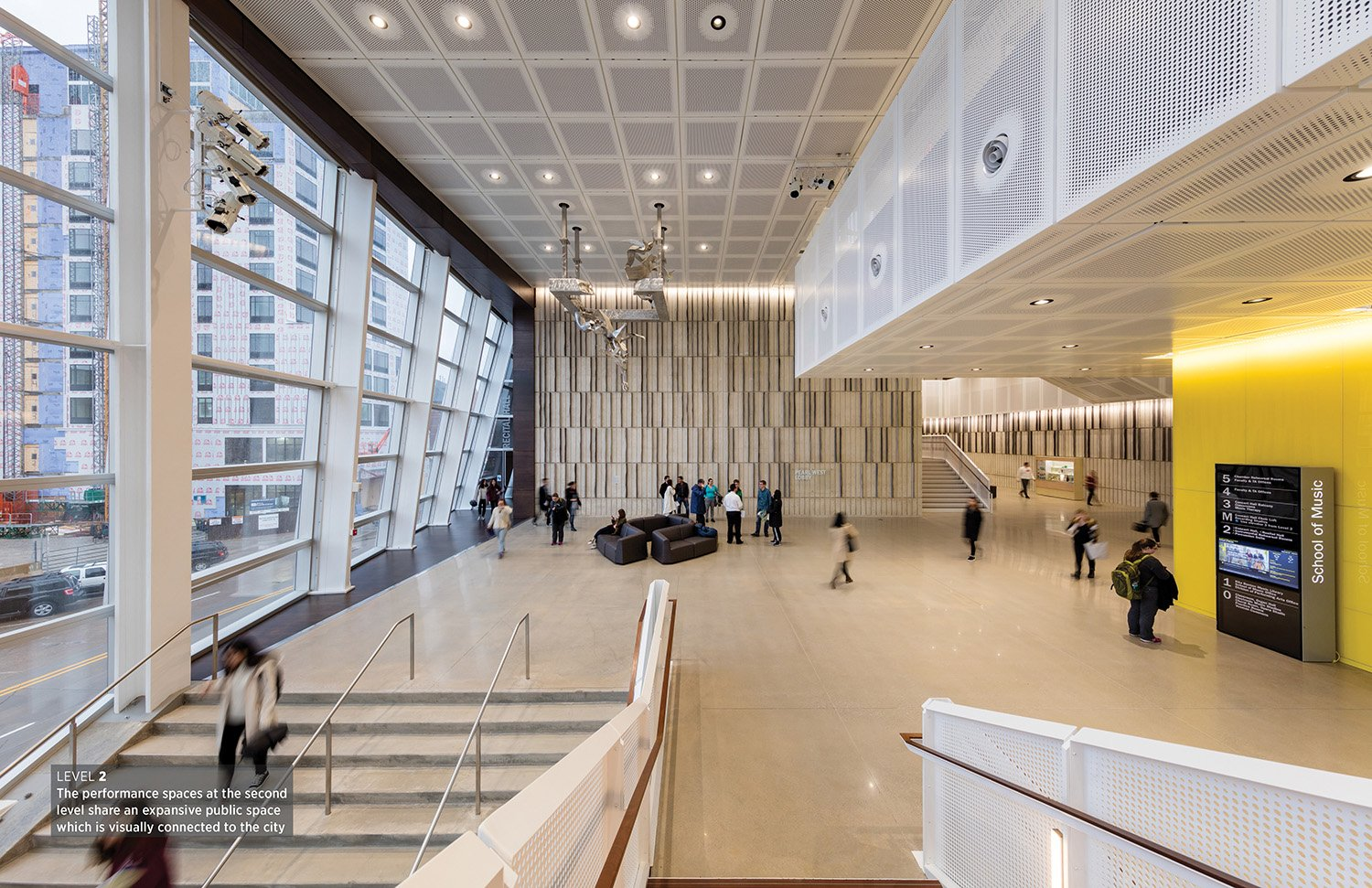 Performance spaces at the building's second level share an expansive public space that visually connects with the city. Tim Griffith