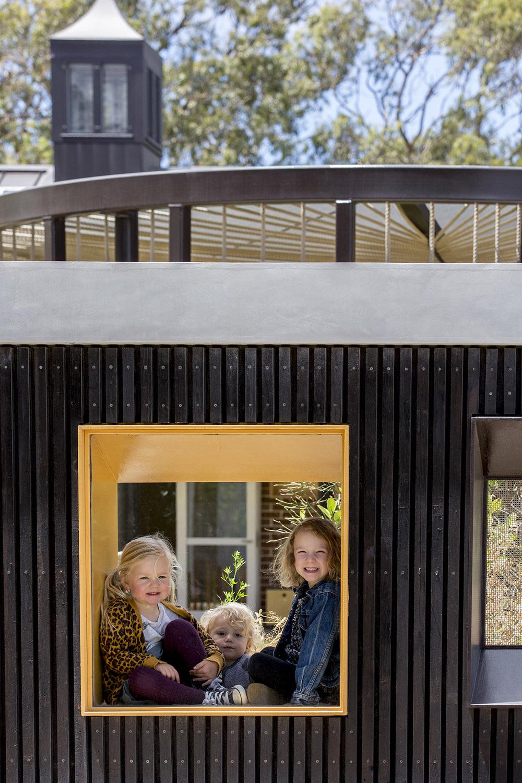 Protruded steel window reveals provide play areas for children Brett Boardman