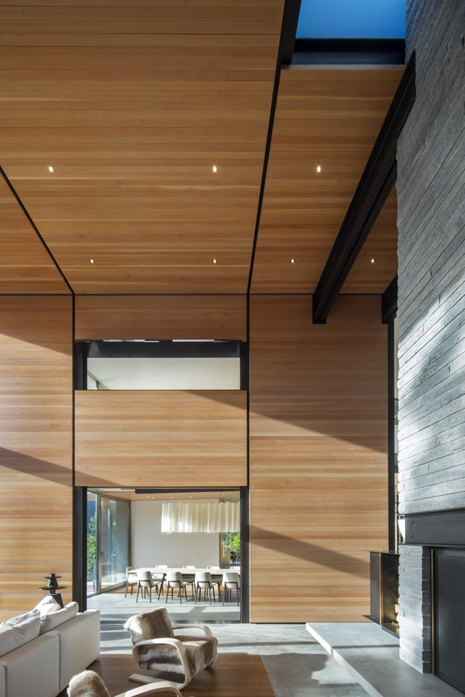 The principal organizational elements of this wing are two, three-story heavy timber boxes comprised of Douglas-fir timber paneling. The wood for these spaces and the cantilevered view decks was harvested