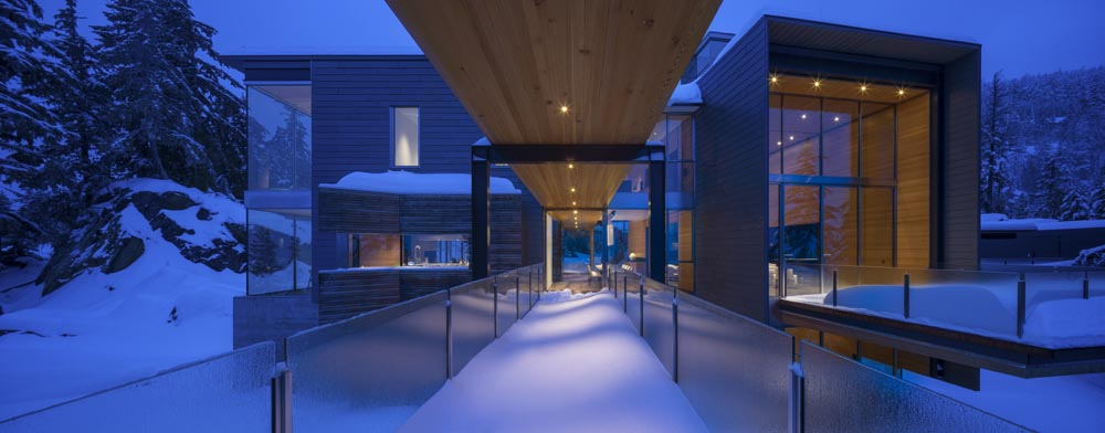 Terraces and cantilevered porches visually extend interior spaces into the landscape.