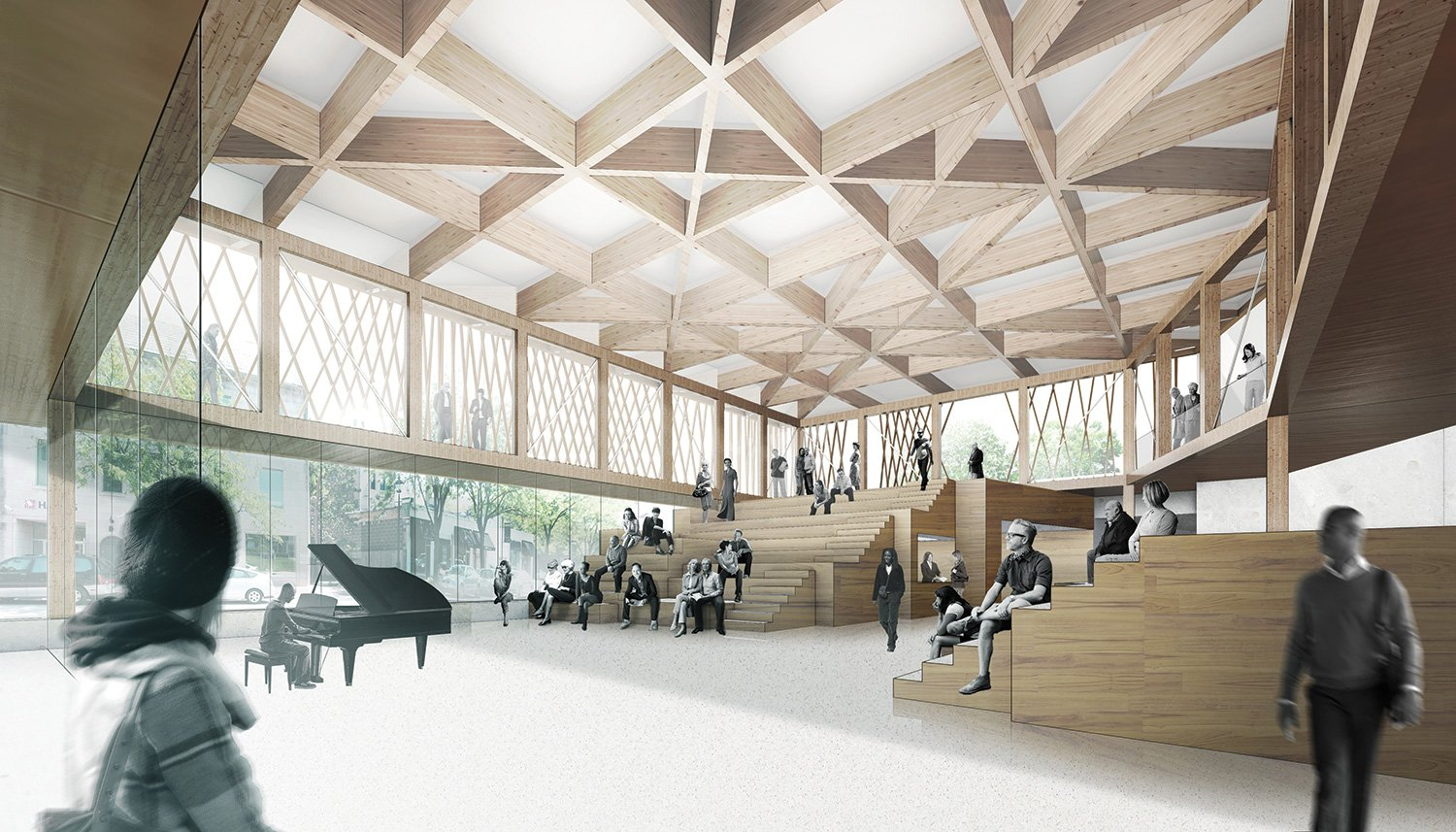 The lobby is designed to accommodate the spoken word, providing opportunities for informal performances, events, and educational programs. Acoustic wood ceiling panels and theatrical lights further its abi }