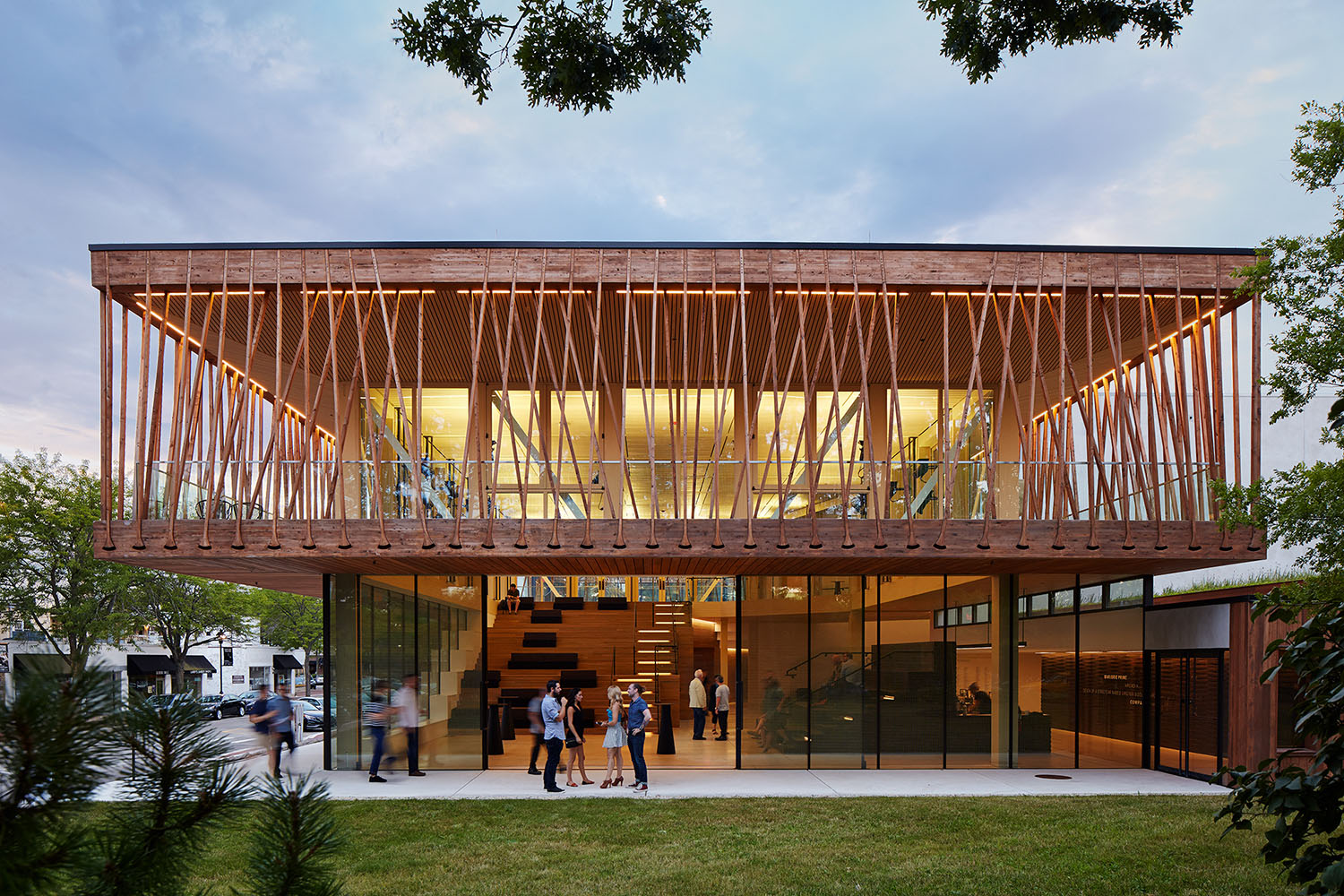 The lobby's transparent exterior, comprising large glass sliding doors, can physically open to the community and nearby parks for open-air performances and festivals, allowing the energy and interaction ge