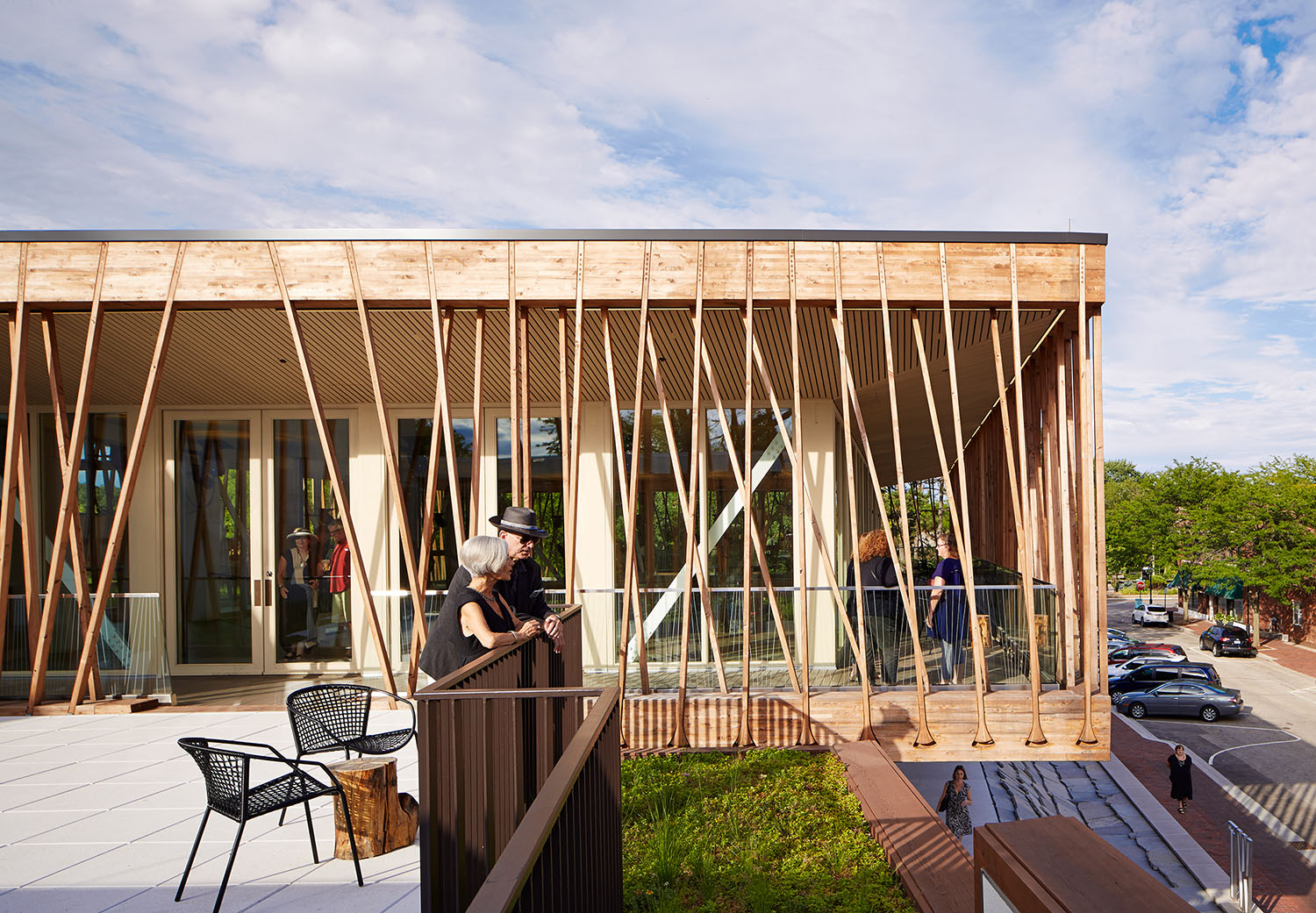 The Canopy Walk is hung from wooden battens performing in tension, and their splayed geometry animates the facade.