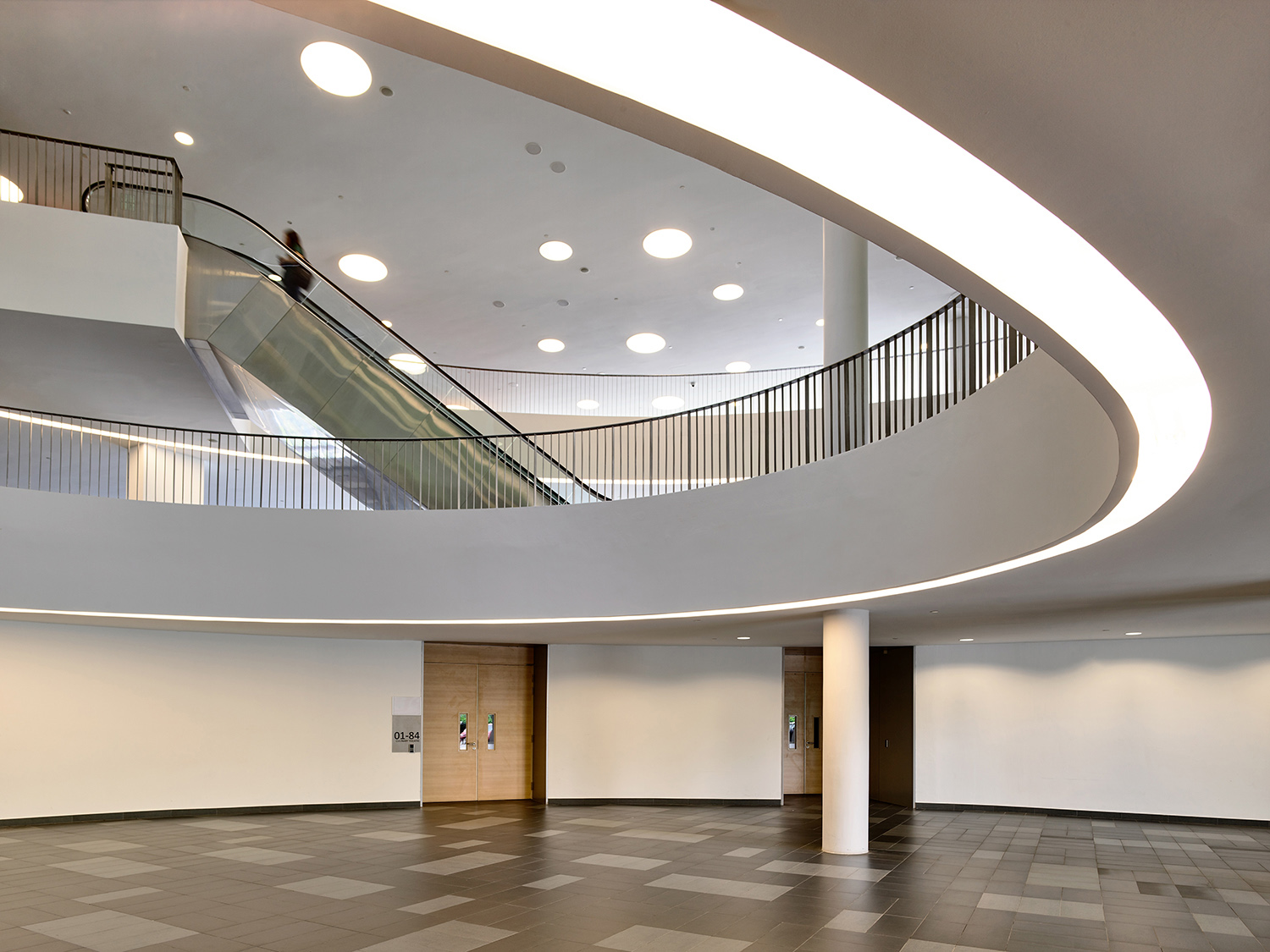 Curved profile of the podium is brought inside into the atrium space
