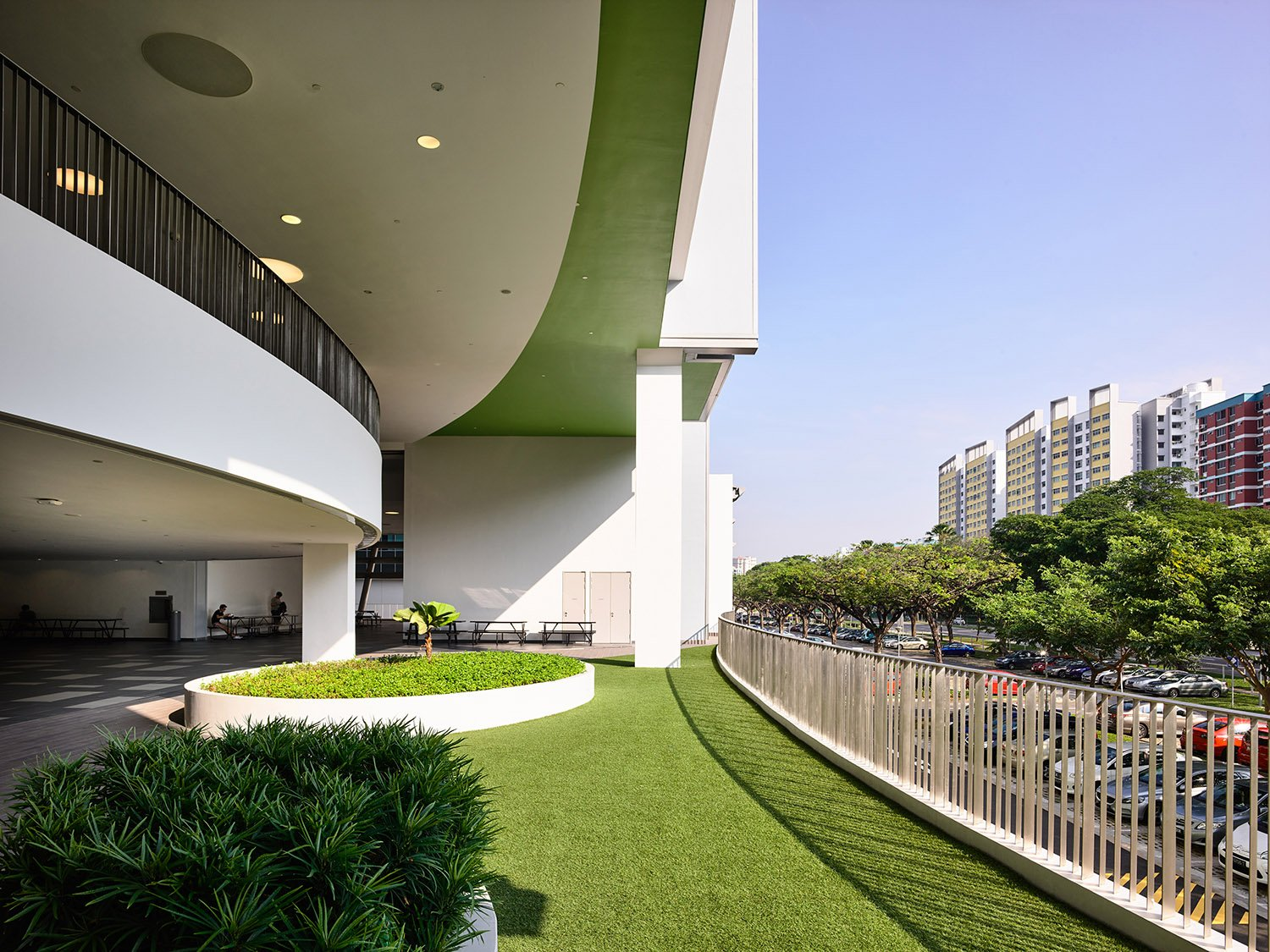 Edges of the podium are interspersed with greenery to further soften the edges