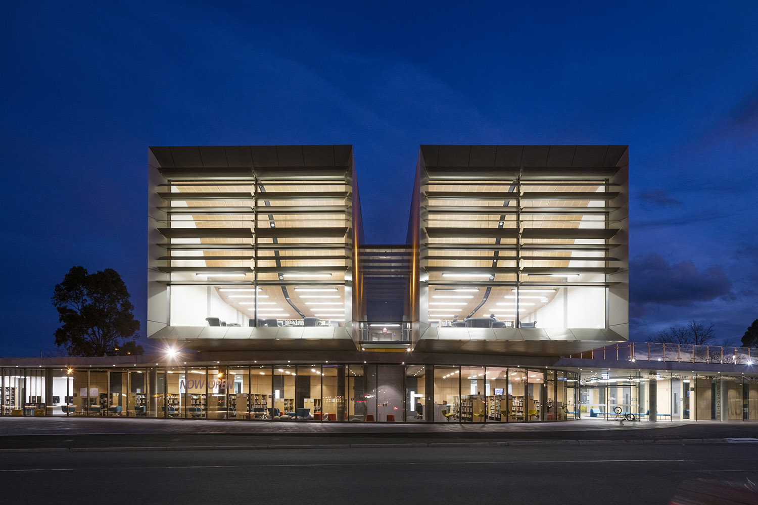 Two timber clad volumes are oriented directly down the main street forming a focus for this civic vista John Gollings