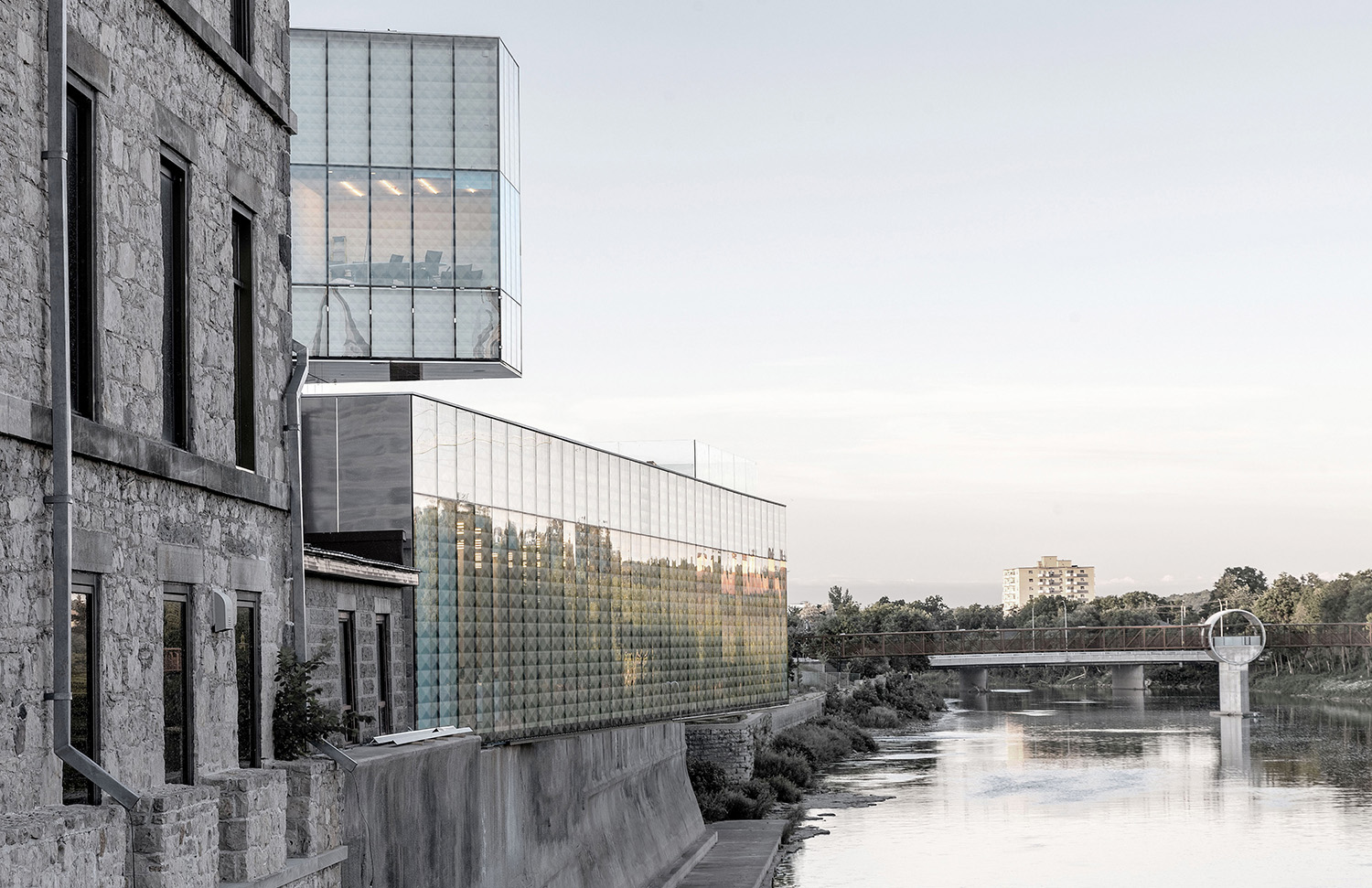 Bridges span the Grand River on either side of the building. RDHA - Sanjay Chauhan