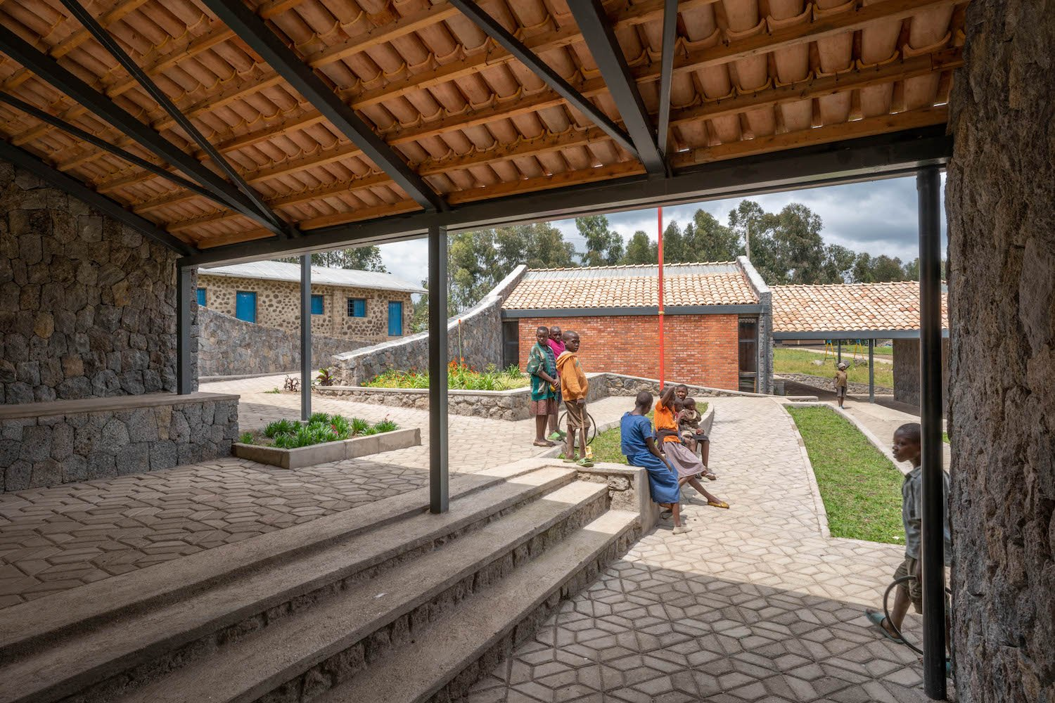 A central plaza at the heart of the campus provides an outdoor assembly space for the school's community. MASS Design Group / Alan Ricks (Full Copyright)