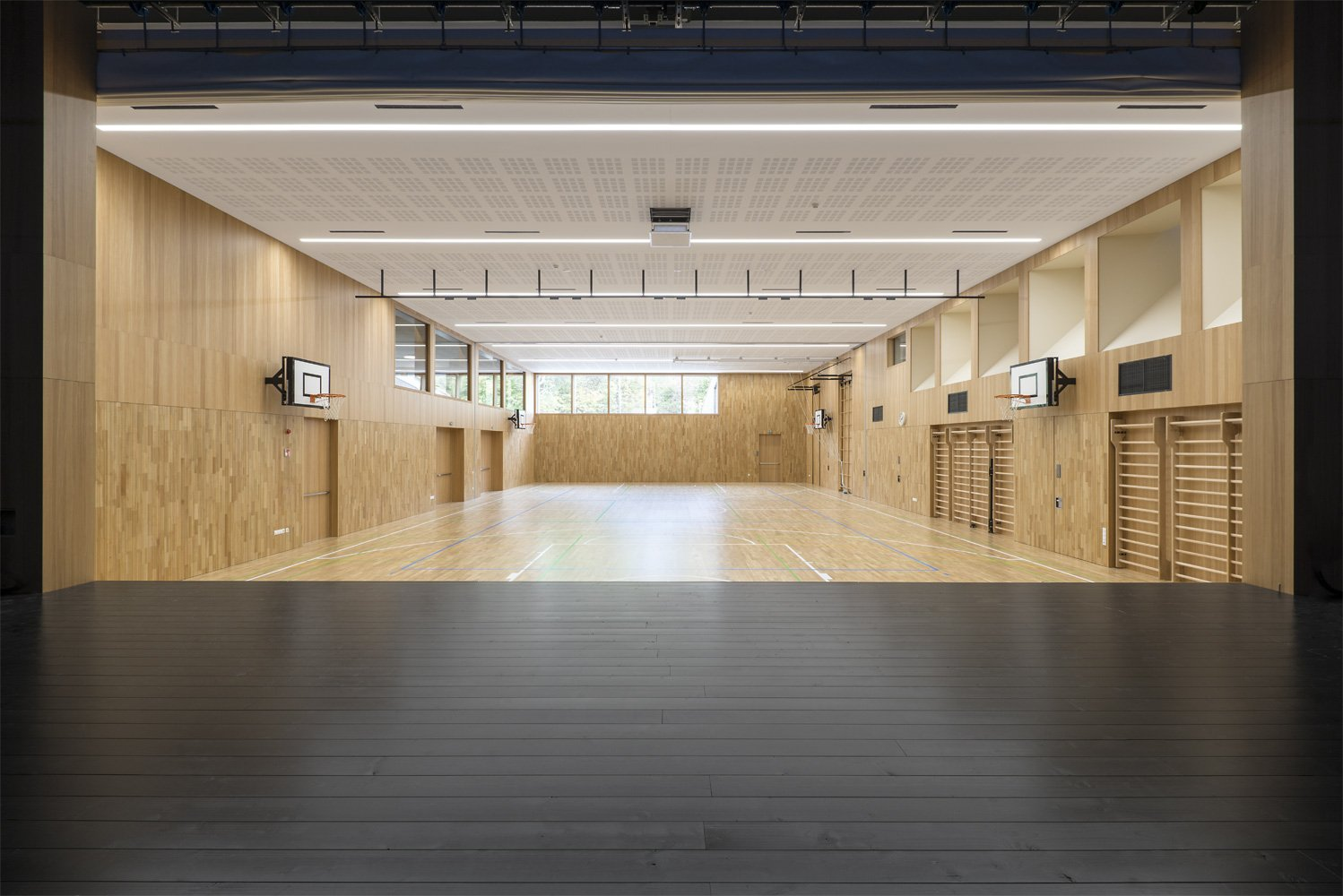 The stage frames the space of the gym / theatre / multiuse hall Oliver Jaist