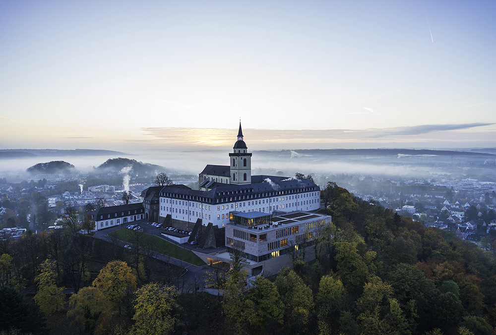 People travelling to Siegburg will notice the city's landmark from a distance, the Michaelsberg Abbey. HGEsch, Hennef