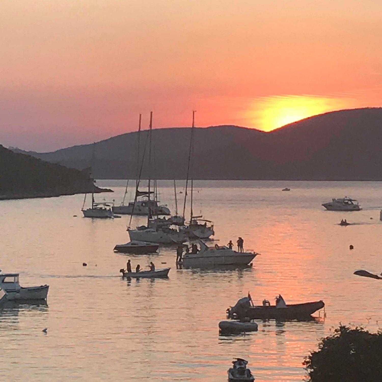 Bigova harbour at sunset mcadam architects