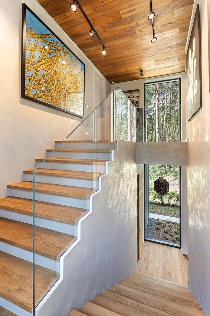 Concrete and wood staircase Szymon Polański/Trzop Architekci
