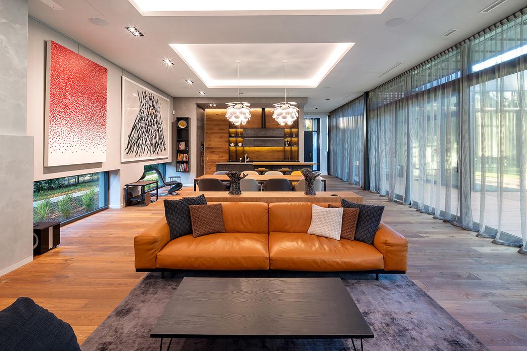 Living room with opened kitchen Szymon Polański/Trzop Architekci