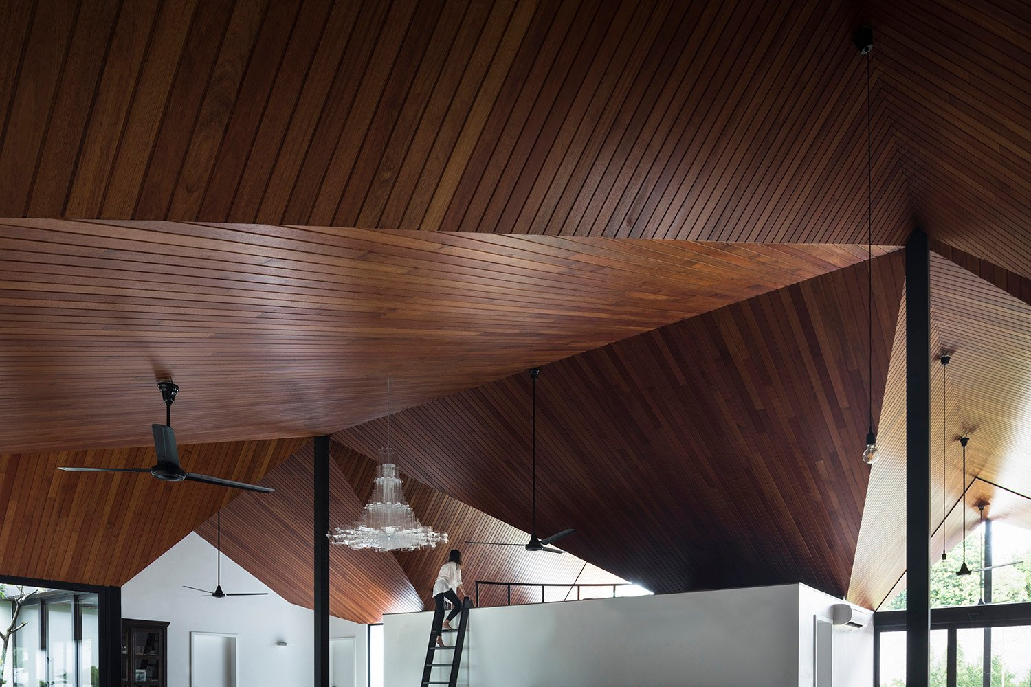 Undulating timber roofs form the main architectural element of the space. Fabian Ong