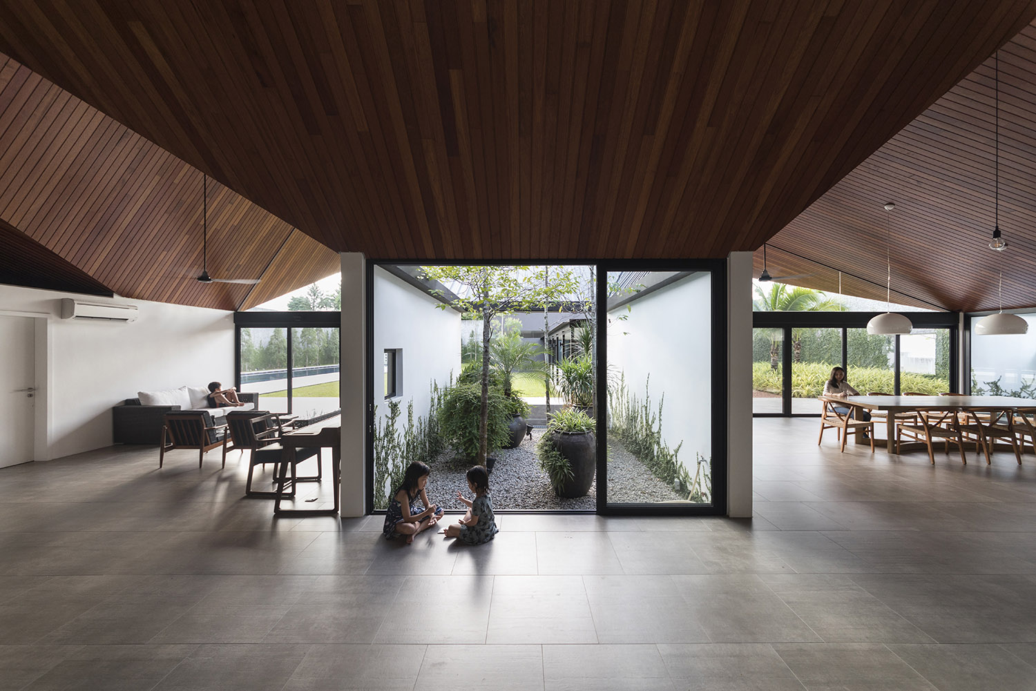 Without the presence of walls, living occur organically in the communal spaces. Fabian Ong