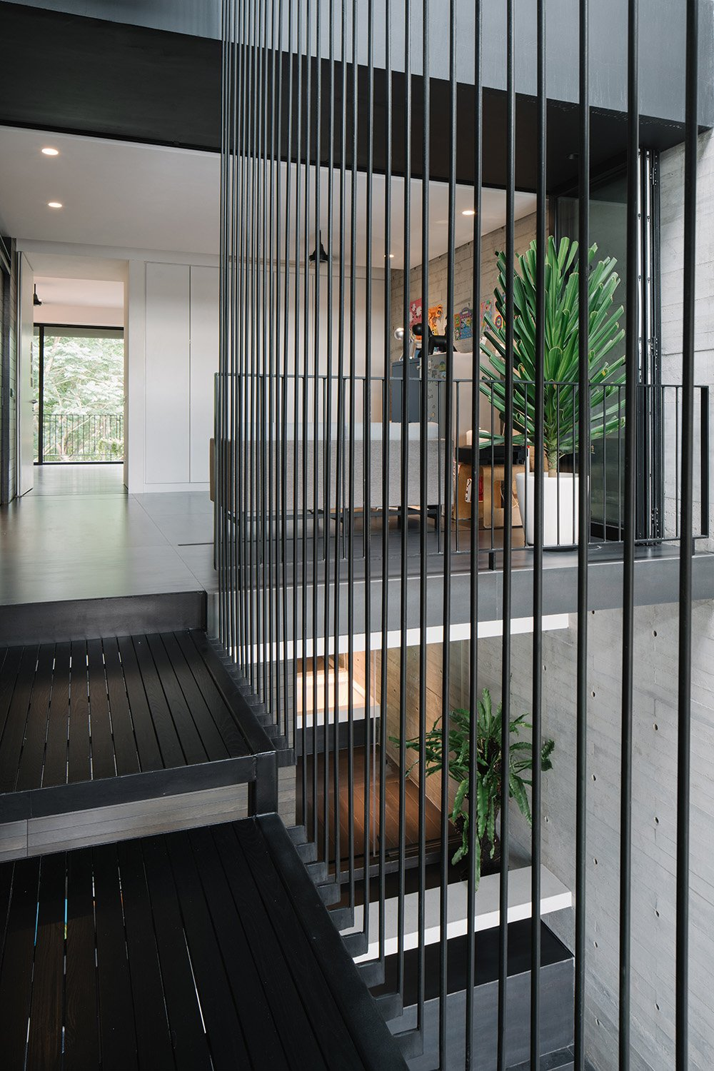 Room surround the central atrium which houses the pool on the second story. Marc Tan