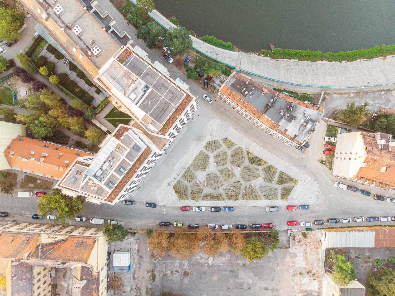 a bird's eye view of building and public square Maciej Lulko