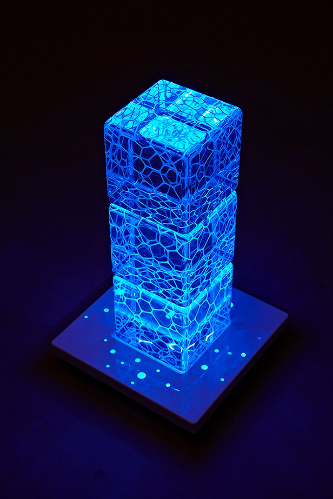 On one base, cubes can be stacked up as high as needed (blue lights on) Su Chen
