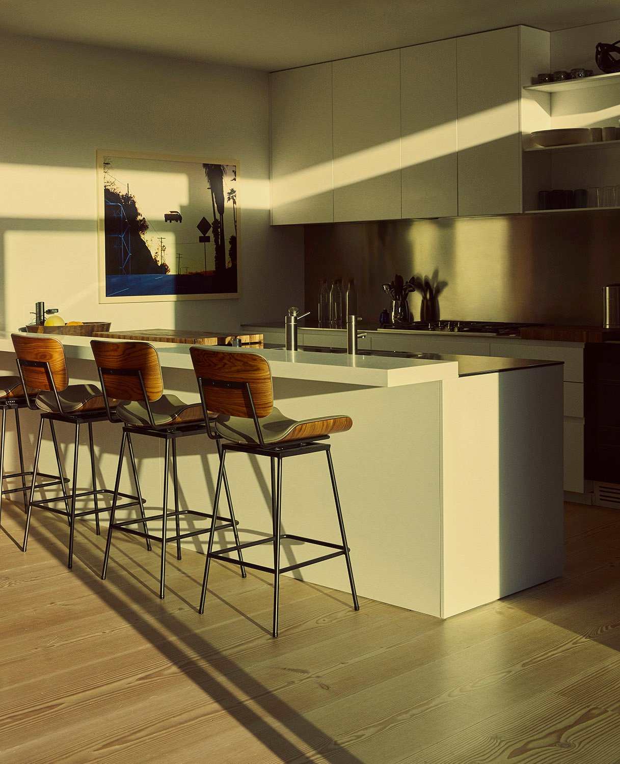 The appliances are by Miele and the Cojo stools are by Thomas Hayes. Miller Mobley