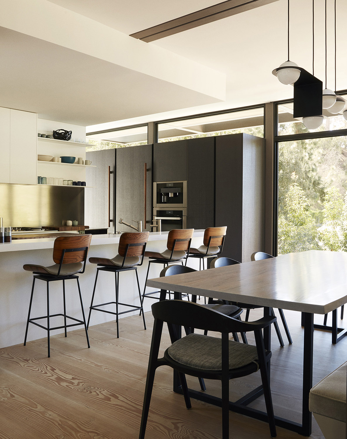 The kitchen's dark-stained oak millwork and Corian-and-steel countertops were made by Ernestomeda. Miller Mobley