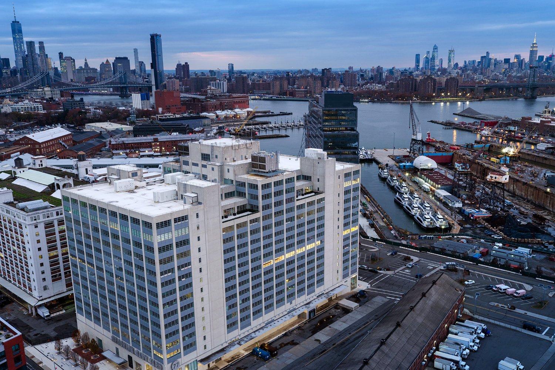 Aerial view, Building 77, 8th Floor illuminated. Michael Moran