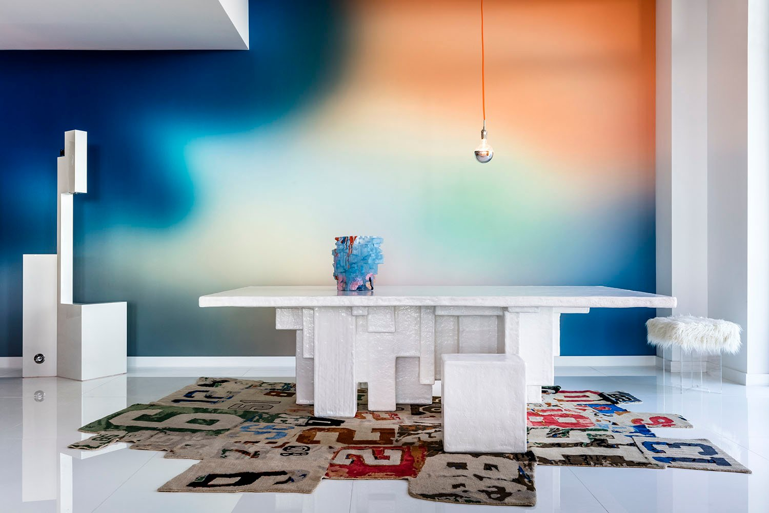 The dining area is set against a backdrop of Aura wallpaper by Calico, illuminated by lighting designed by the illustrious Johanna Grawunder. Kris Tamburello