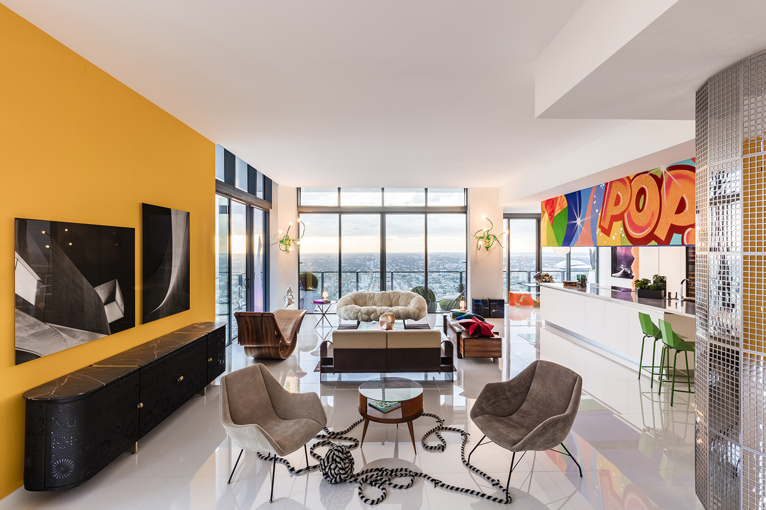 The living area holds its own against the backdrop of expansive views with stellar works by icons of Brazilian design. Kris Tamburello