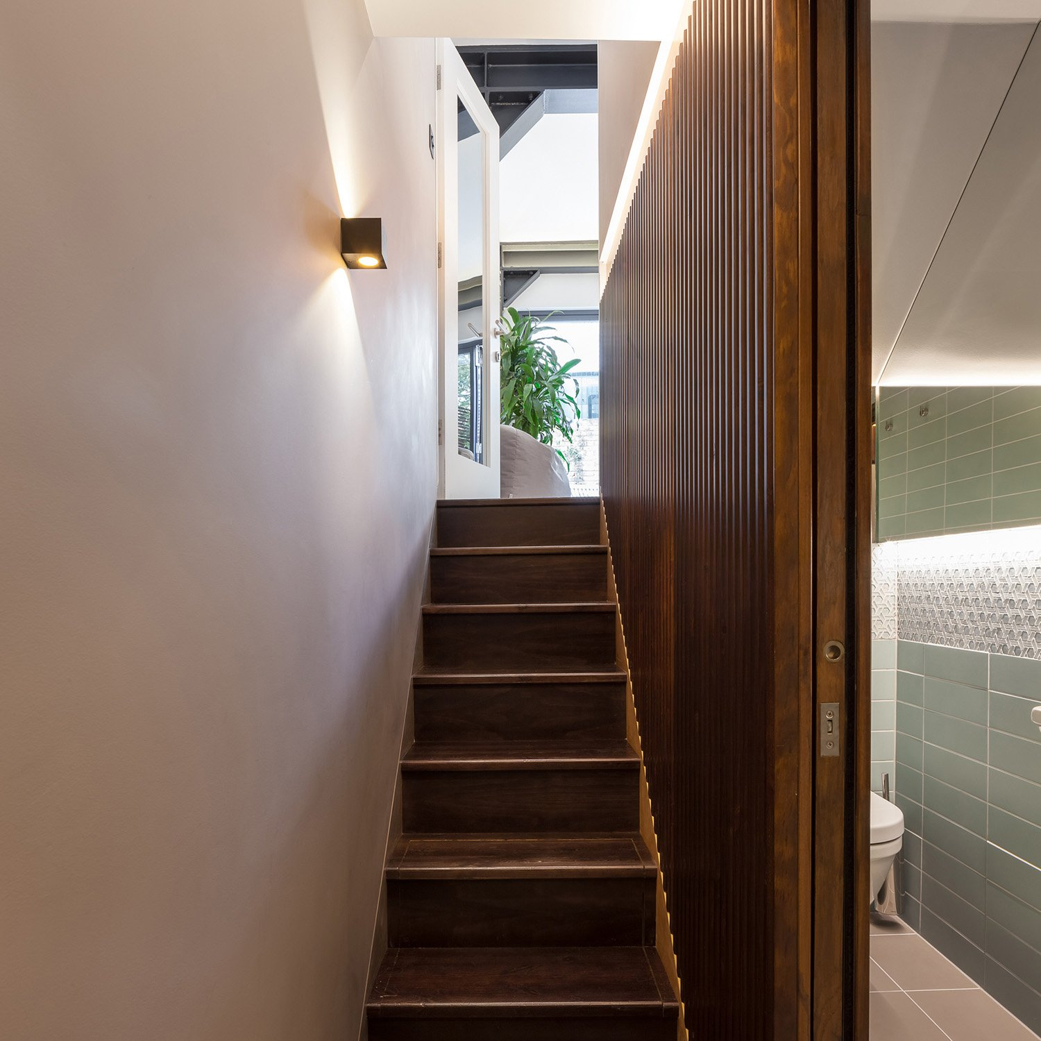 Timber cladding in the basement leading to the kitchen Peter Landers