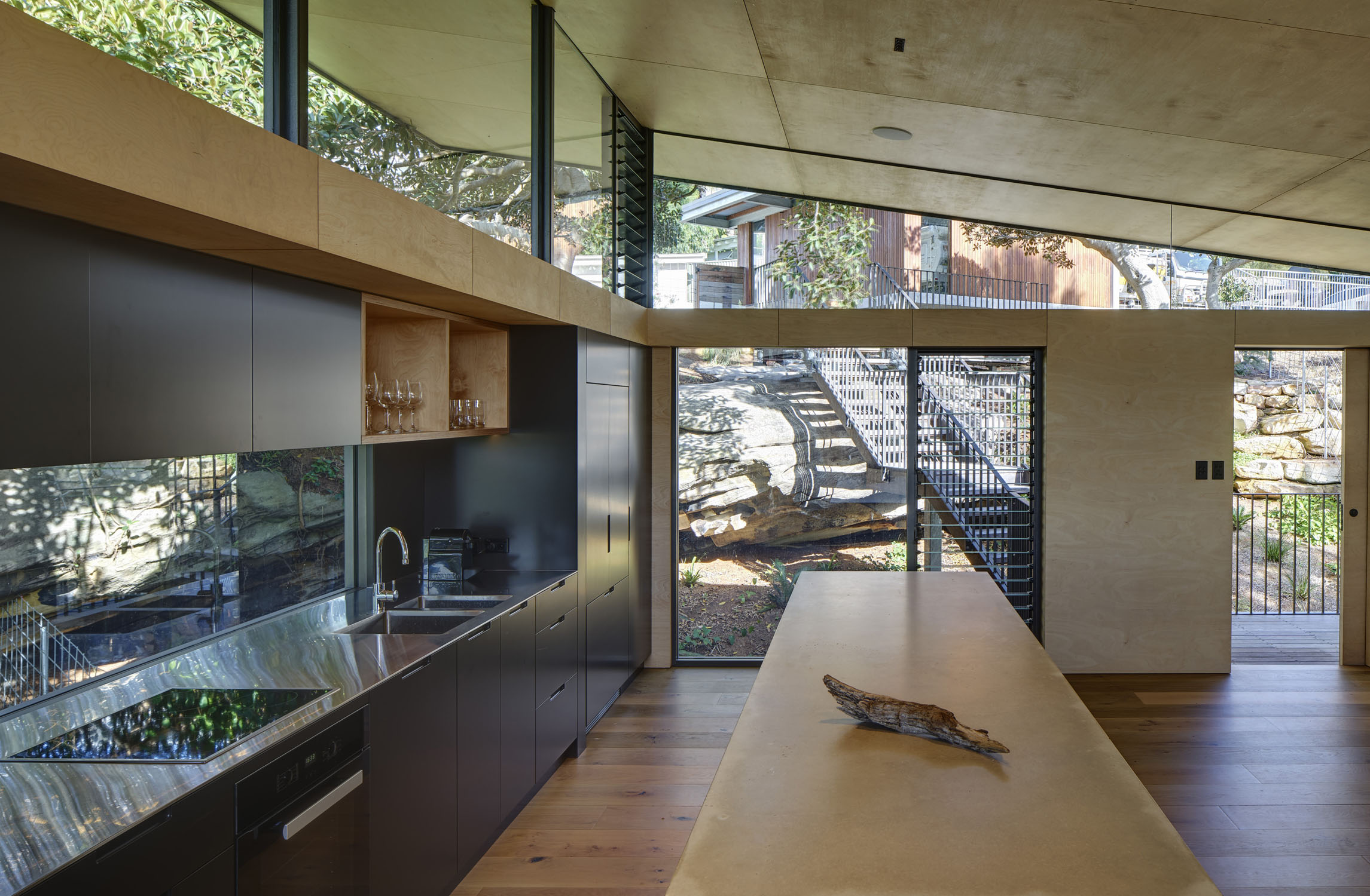 Kitchen as pivotal point of house, views to entry Michael Nicholson