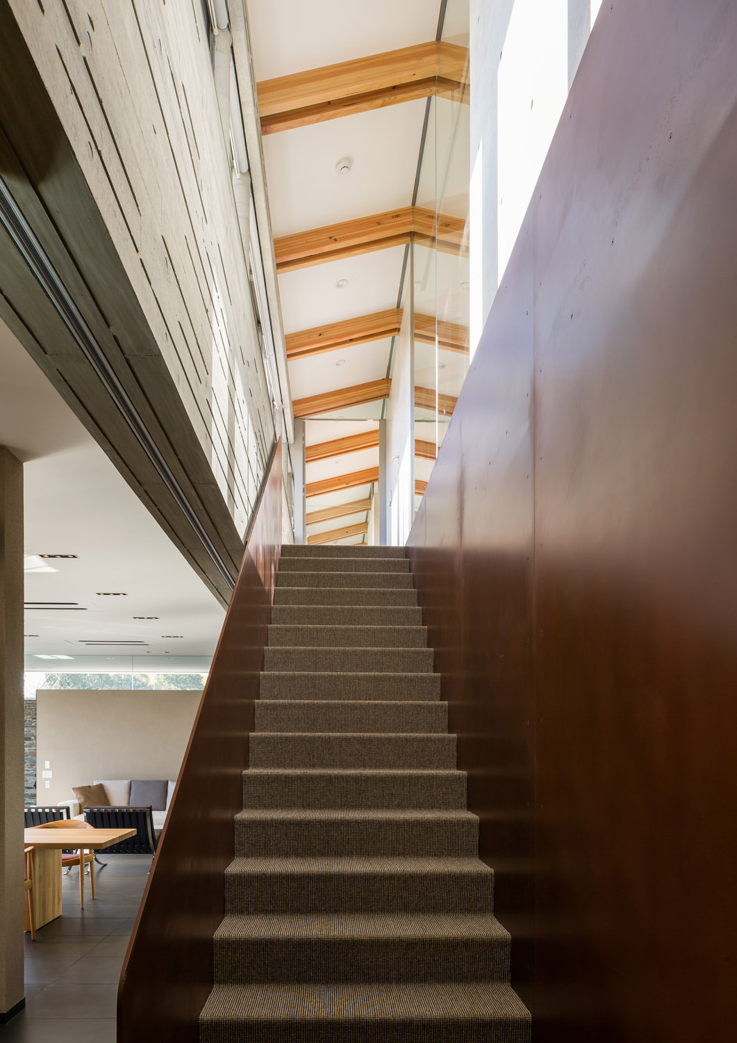 stairs of weathering steel going up to the second floor KIAA