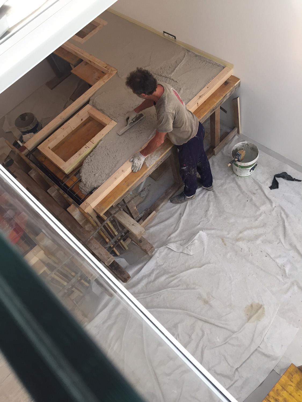 foto di cantiere: la lavorazione del getto Arbau studio