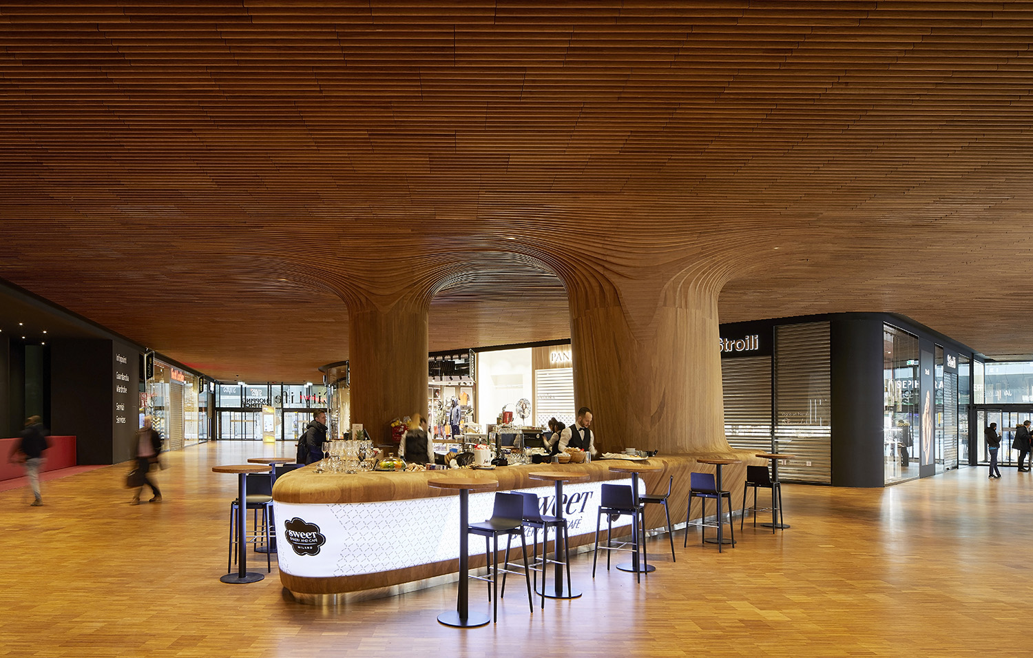 Interior view of retail space within the Generali Tower podium Photograph by Hufton + Crow