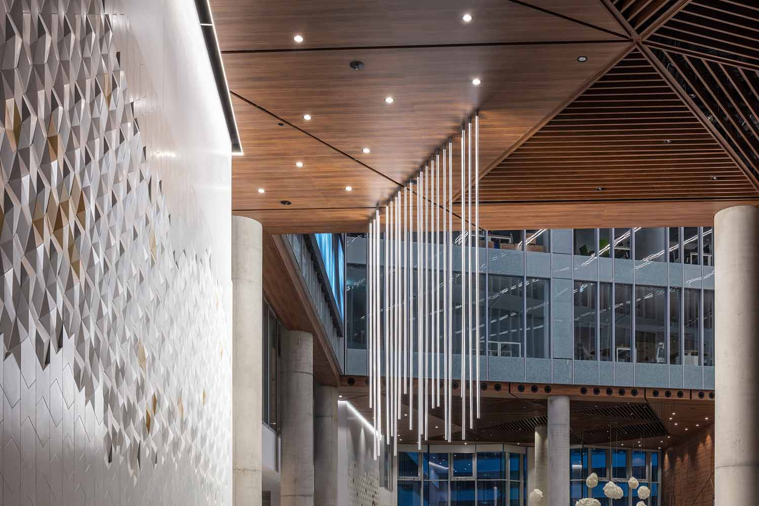Main Recepction and Atrium - Detail with 3D TIBA Tiles, Suspended lighting and Ceiling TIBA Architects Studio kft}