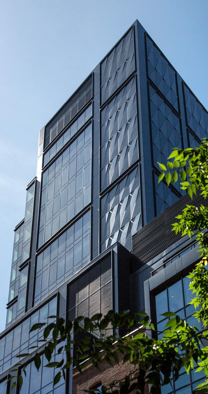 Custom metal panels imported from Italy provide a modern interpretation of the neighborhood fabric David Sundberg | ESTO