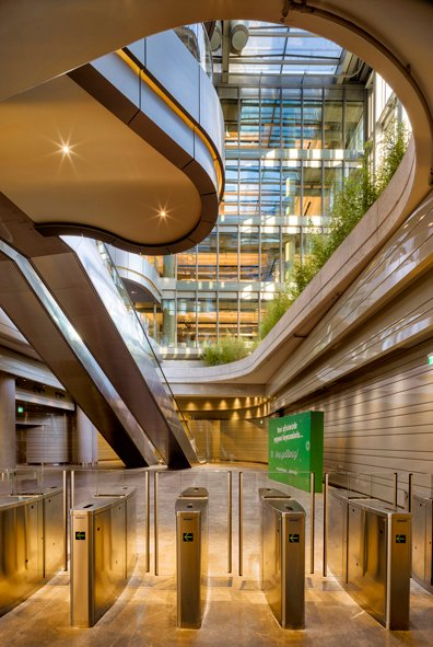 The user crosses an elevated garden on the way to their workplace, a view from on of the main lobbies Cemal Emden