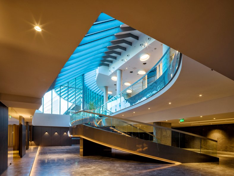 Educational spaces are combined with the auditorium foyer. The carved hills skylights allows daylight to penetrate to the spaces below ground. Cemal Emden