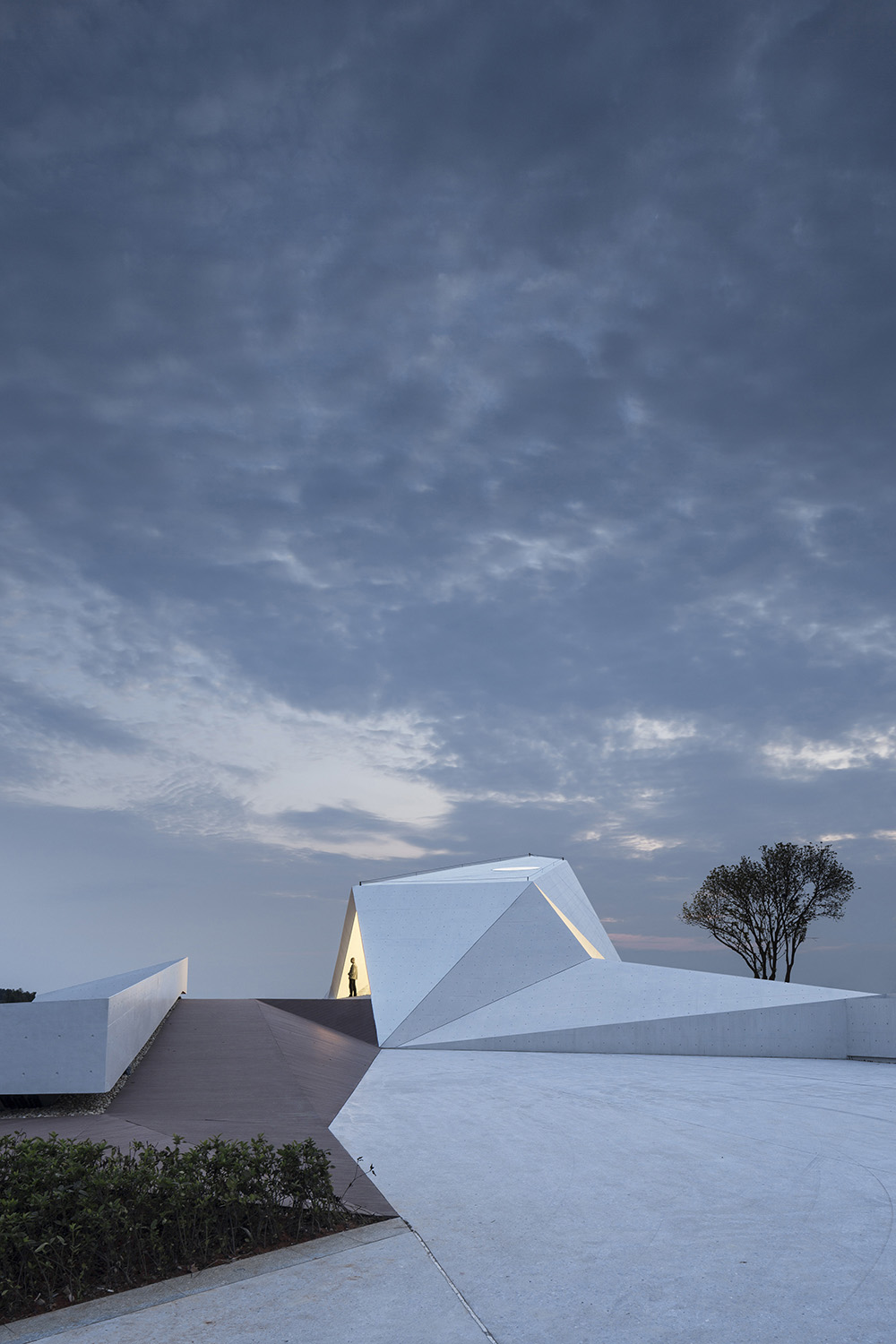 Delicate creases are articulated in the hand-polished concrete exterior Yao Li