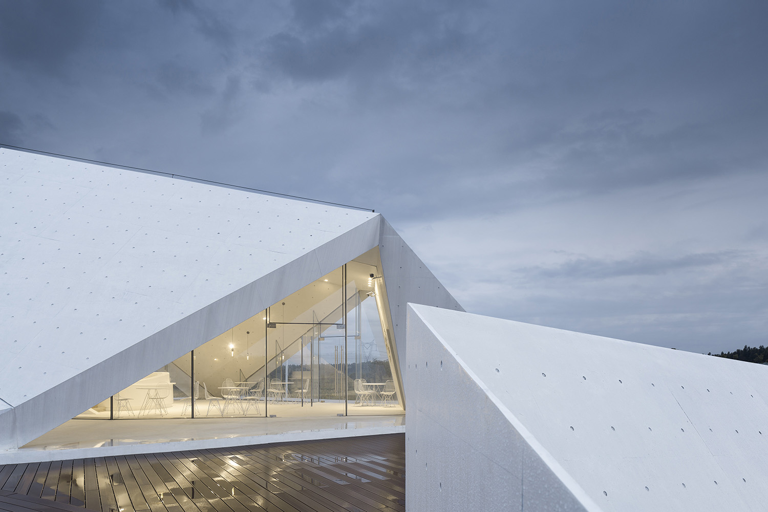Cast with precision, the white concrete holds glass panels that ultimately enclose the space. Yao Li