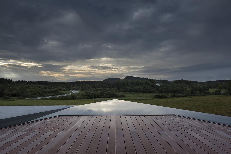 Observation deck overlooking wetland preserve Yao Li