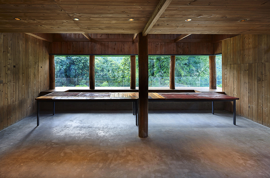 The prviousely dark and enclosed interior space is opened up by three big windows. This is the Window of Tea. The big table top made of old door boards Su Chen