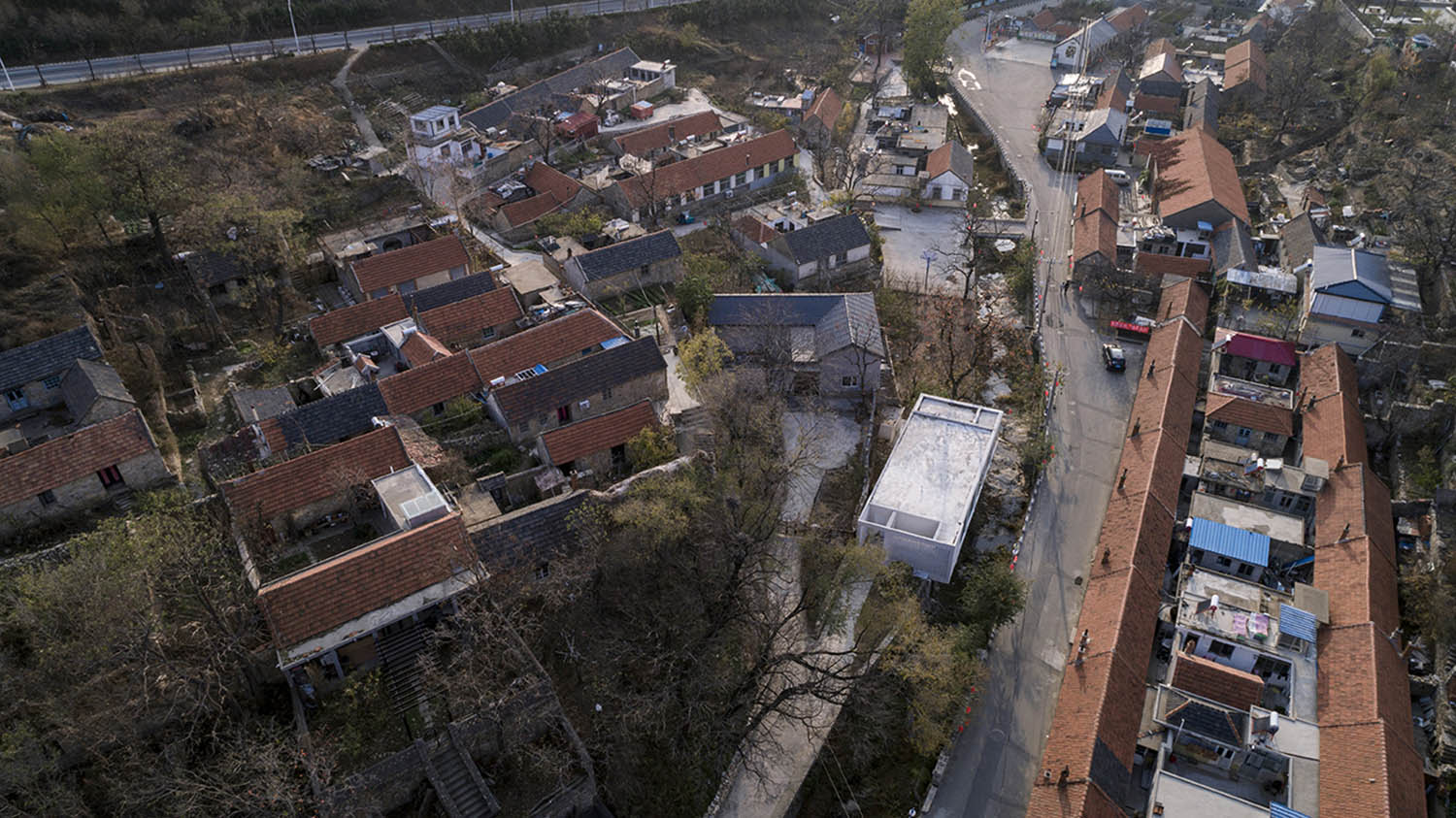 (Mica-Bar) Aerial view of Mica-Bar,New residents surrounded by ancient dwellings Jin Weiqi