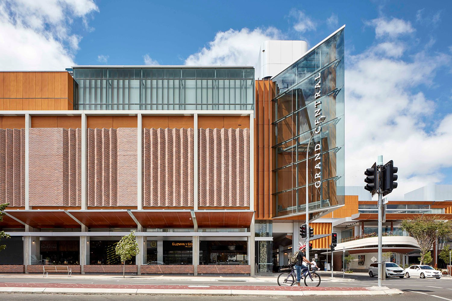 The two storey scale of the streetscape is respected and a rhythmic facade of precast frames and folded brickwork incorporates retail shopfronts, awnings and a generous colonnade Christopher Frederick Jones