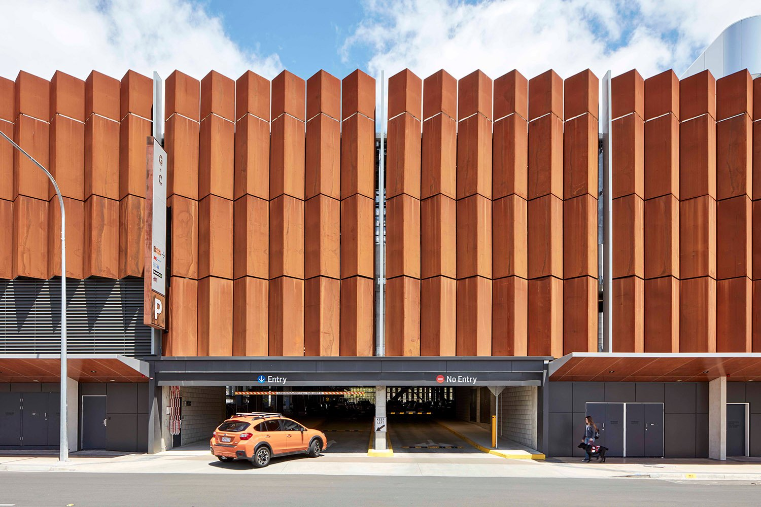 The carpark is wrapped in folded weathered steel allowing natural ventilation and recalling the robust local vernacular. Christopher Frederick Jones